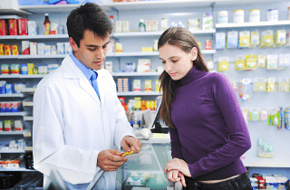 pharmacist advising a client at the pharmacy
