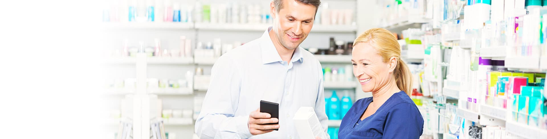male customer and pharmacist smiling