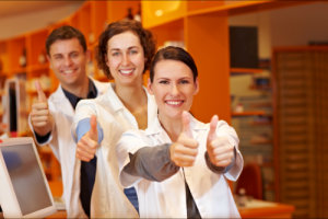 group of pharmacists showing thumbs up