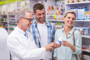 customers and pharmacist laughing